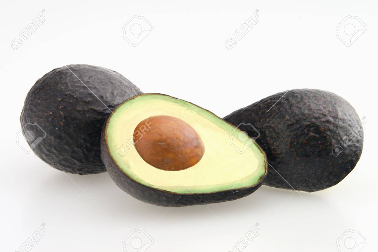 Avocado sliced in half with seed in center Stock Photo - 2549162