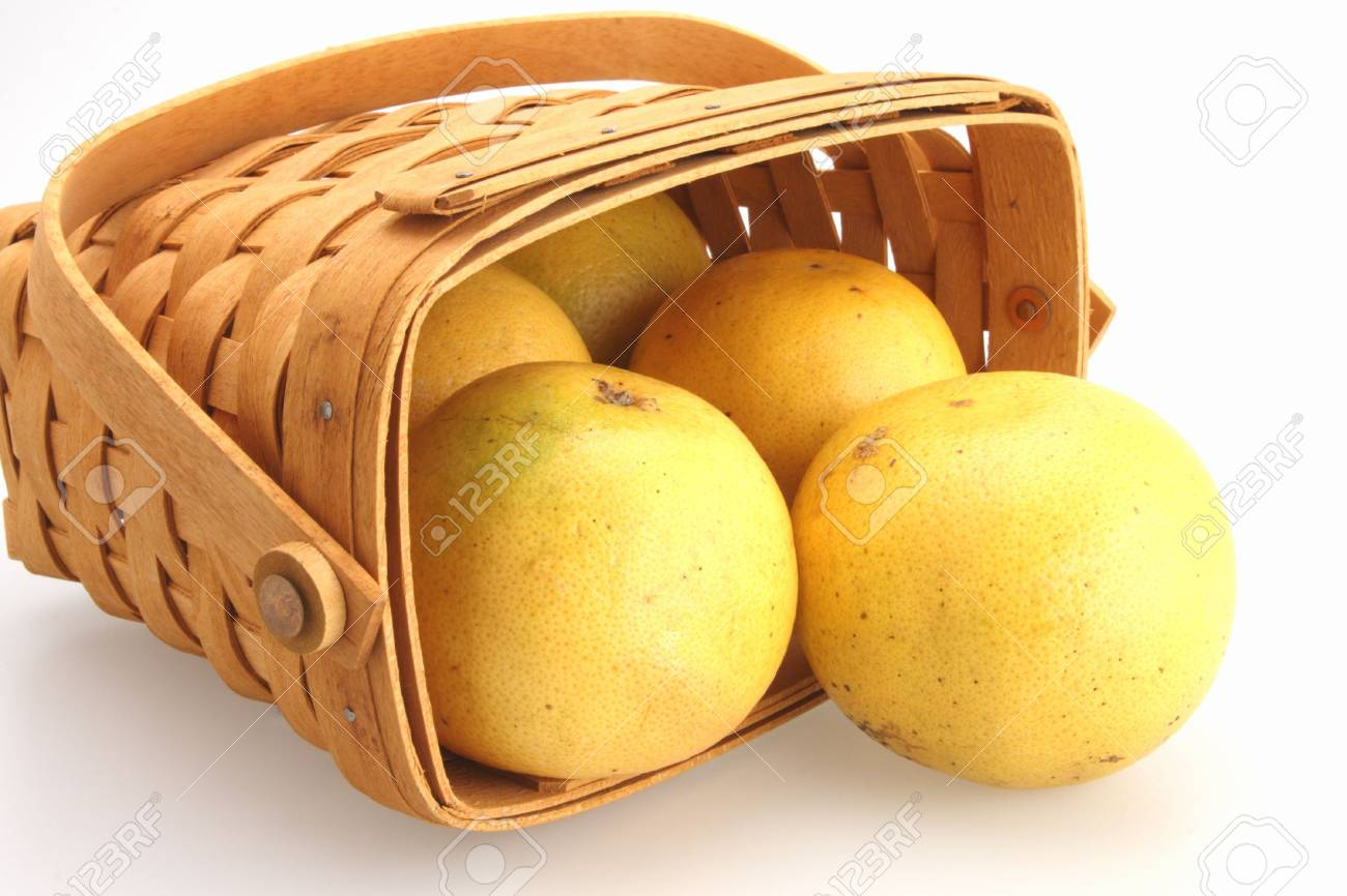 Fresh Oranges rolling out of wicker basket Stock Photo - 2703337