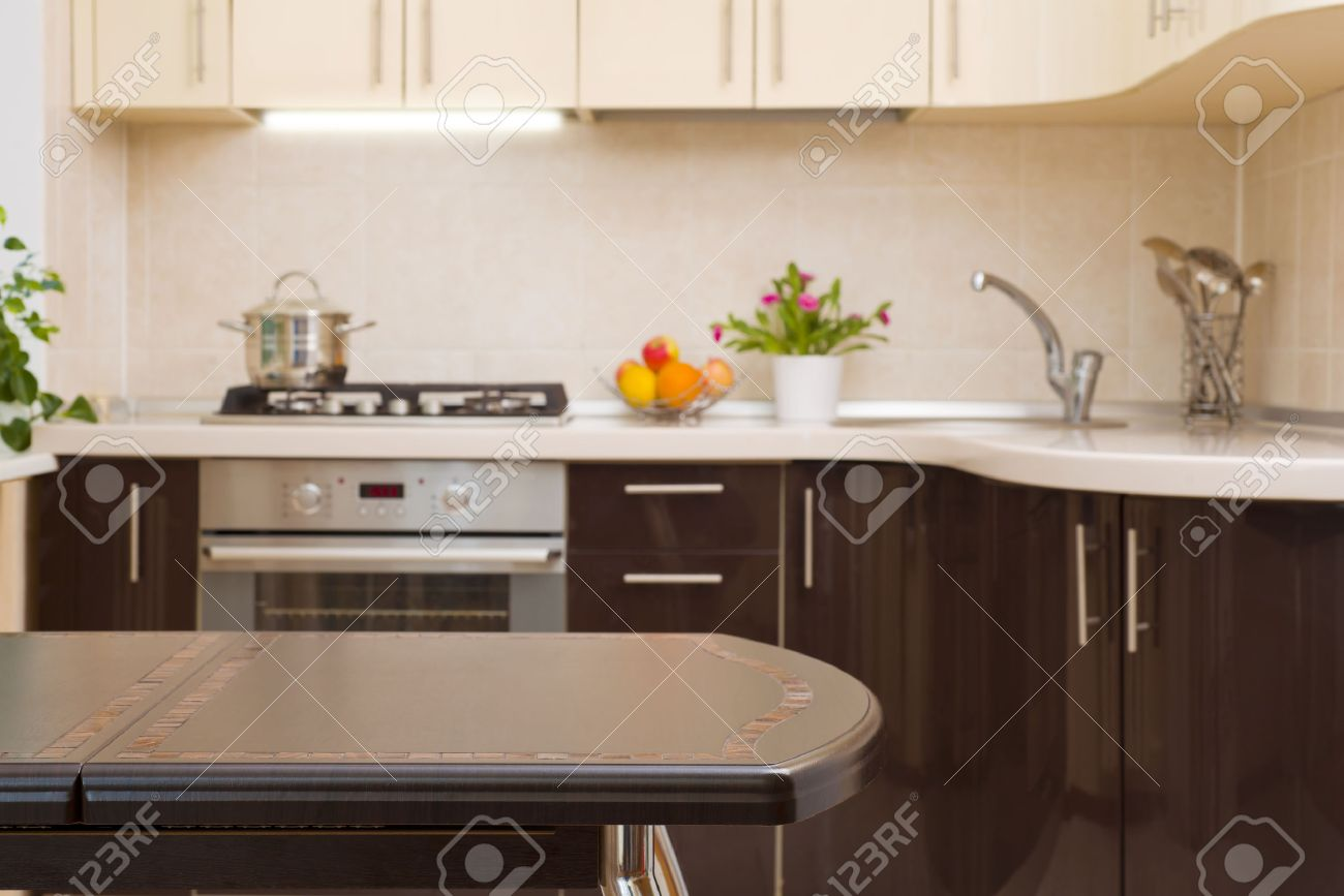 Dinner Table Background dinner table on blurred kitchen interior background stock photo