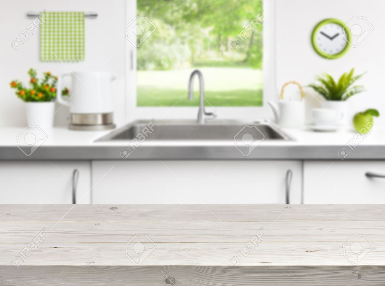 Stock Photo   Wooden Table On Kitchen Sink Window Background