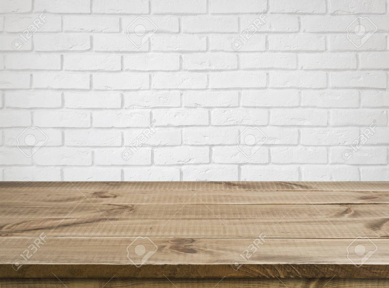 White wooden table texture - Rough Wooden Texture Table Over Defocused White Brick Wall Background Stock Photo 59026546