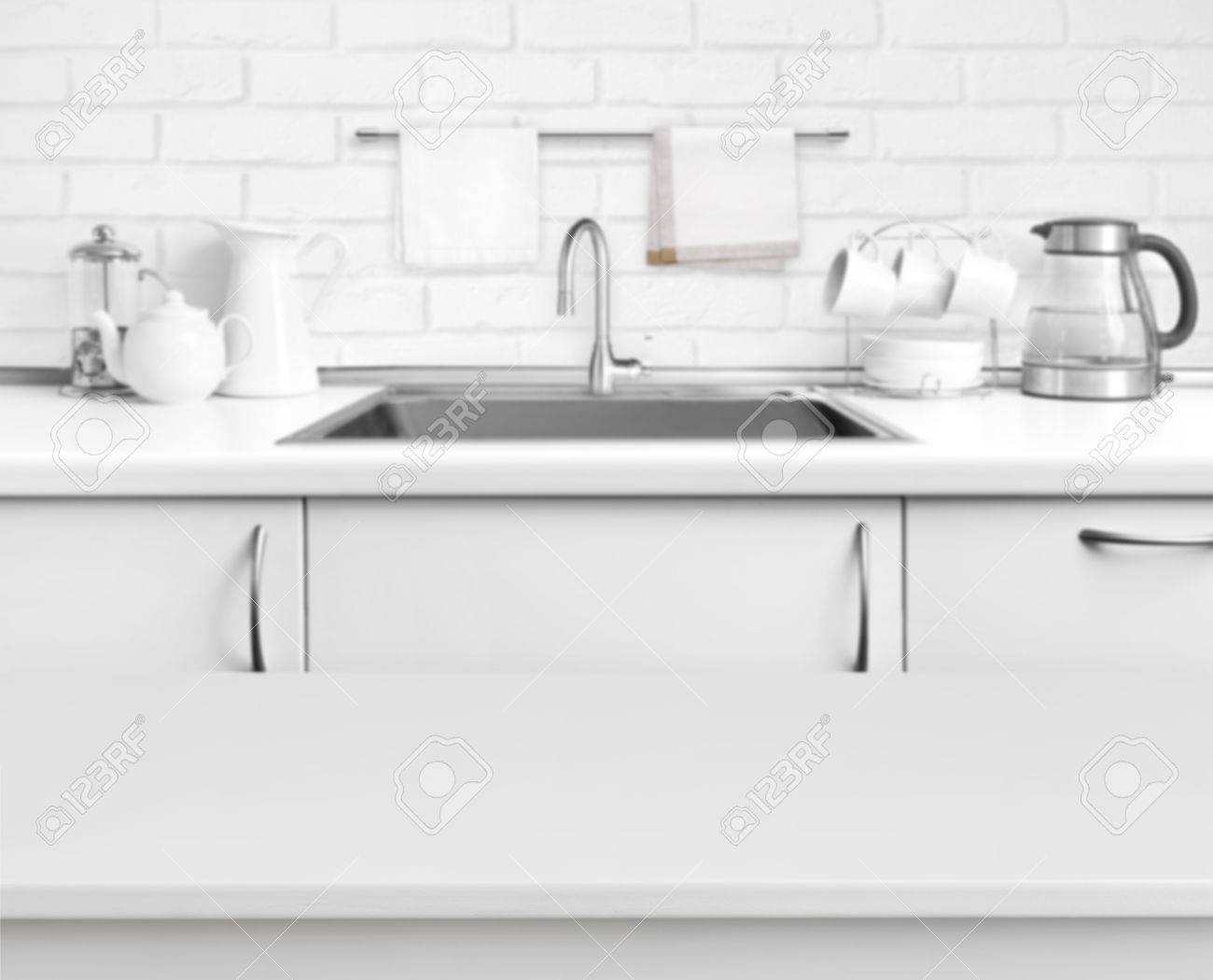 White Laminated Table On Blurred Rustic Kitchen Sink Interior ...