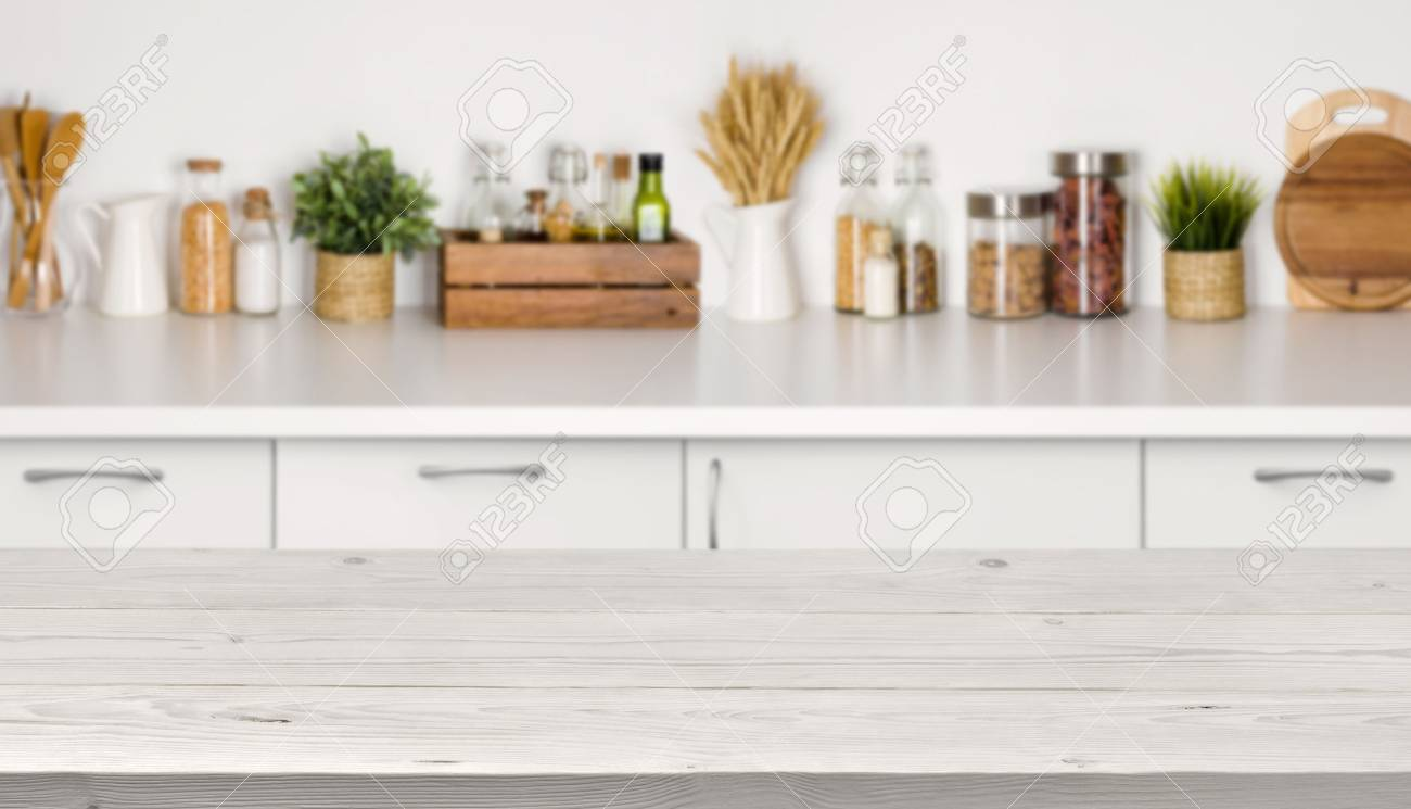 Empty wooden table with bokeh image of kitchen bench interior - 70273105