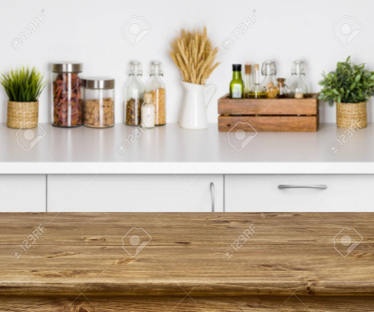Wooden texture table with bokeh image of kitchen bench interior - 70259730