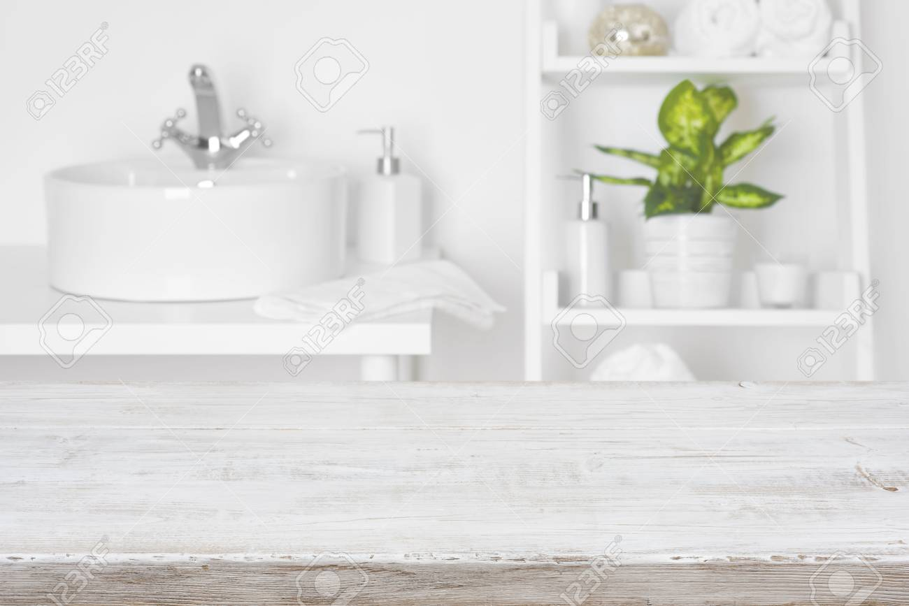 Superieur Stock Photo   Wooden Table In Front Of Blurred White Bathroom Shelves  Background