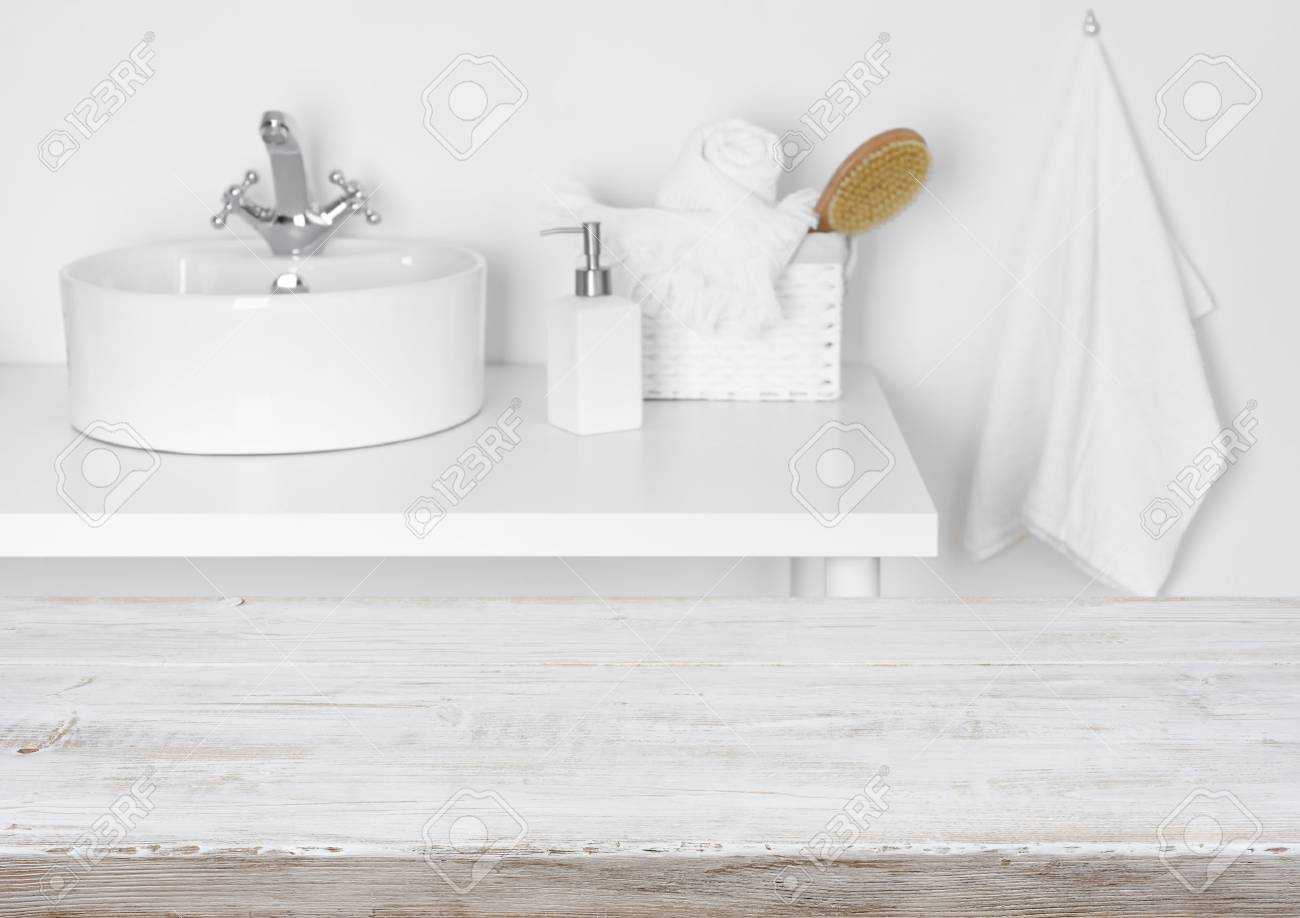 Wooden Table Over Blurred Domestic Bathroom Washbowl Background