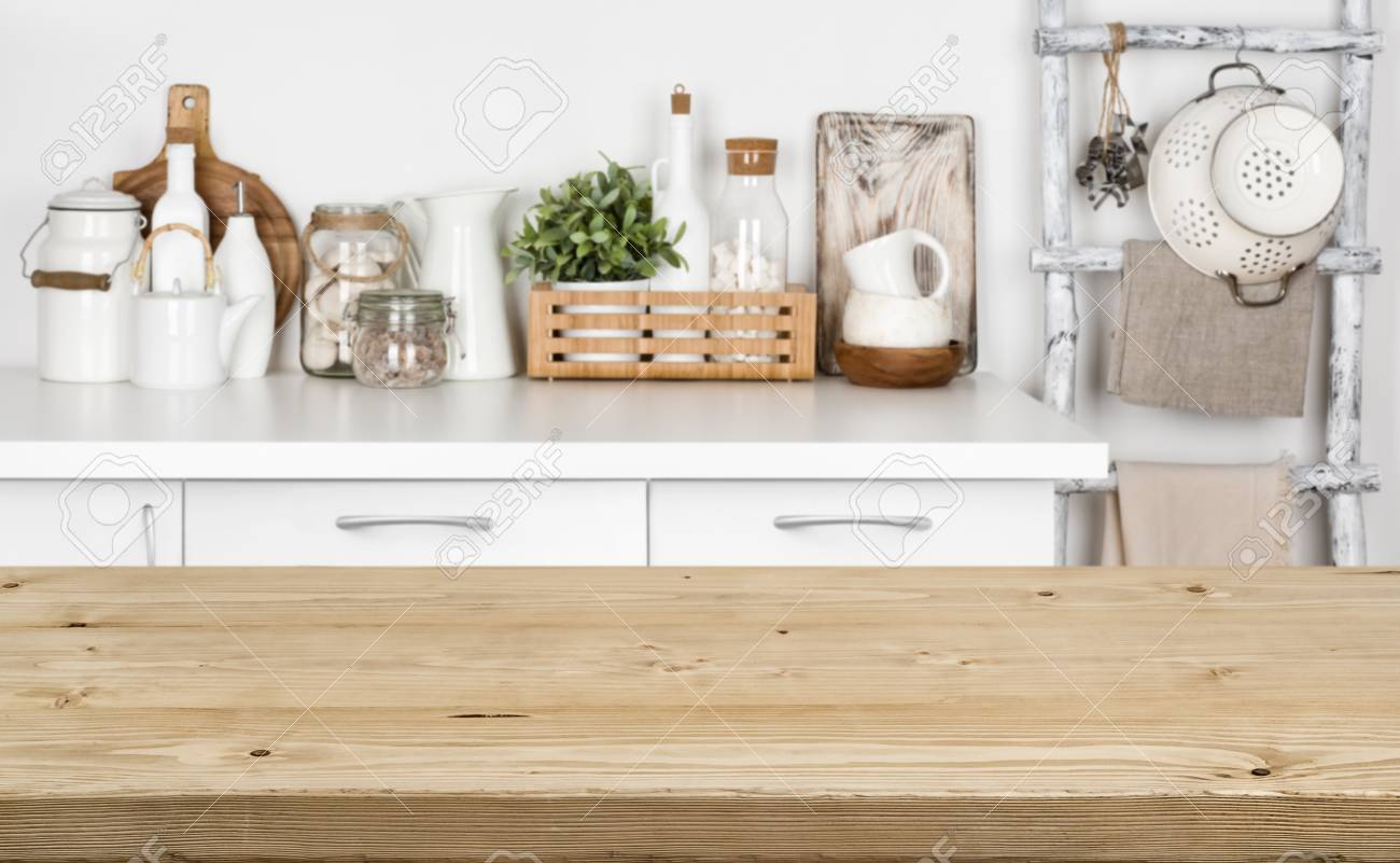 Brown wooden texture table over blurred image of kitchen bench - 92549889