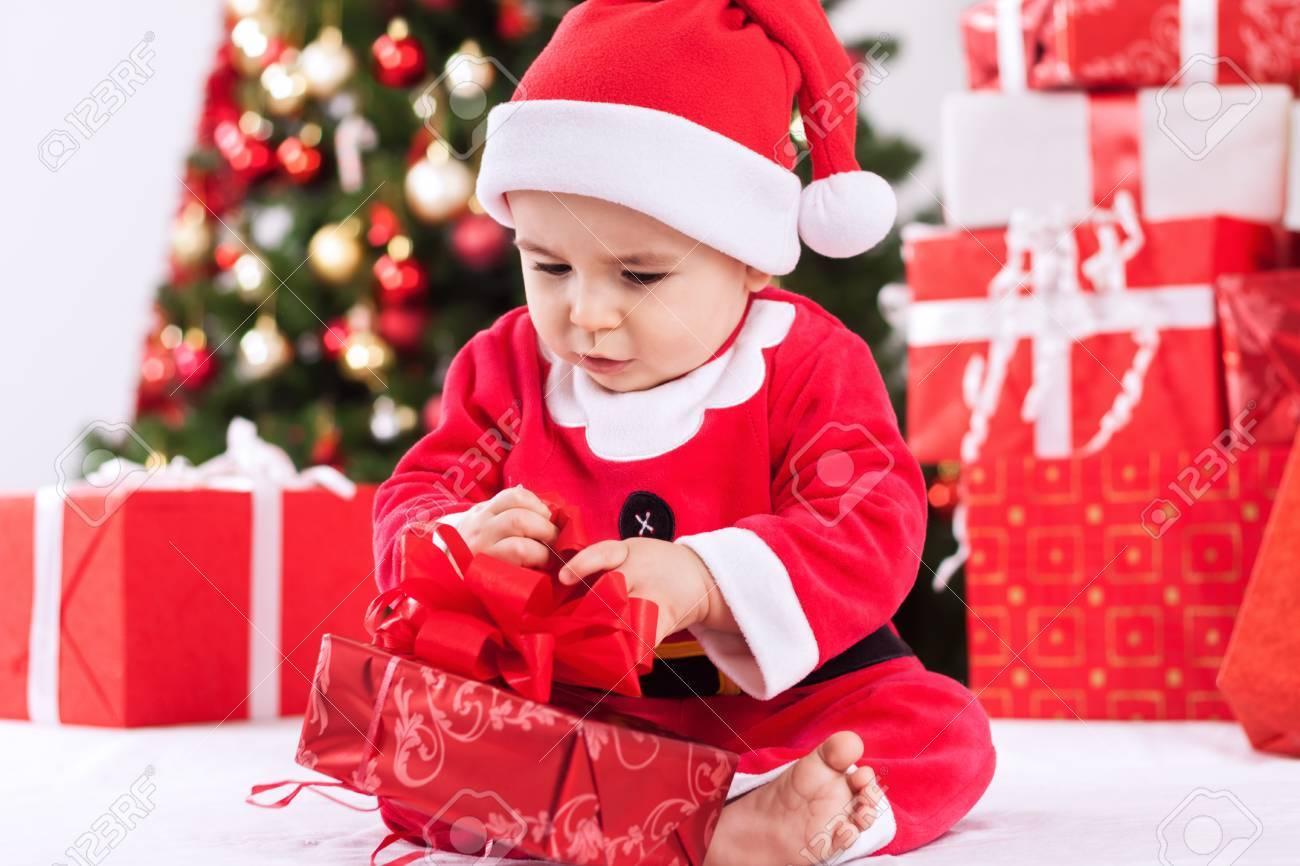 Cute baby child santa claus with gift stock photo 46956373