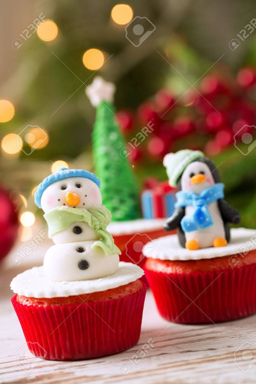 Decorated Cupcakes For Christmas Holiday With Tradition Background