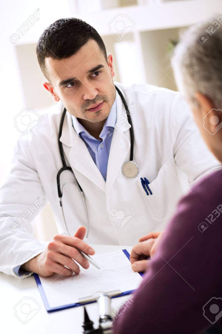 Doctor listening to patient explaining about his painful - 54506373