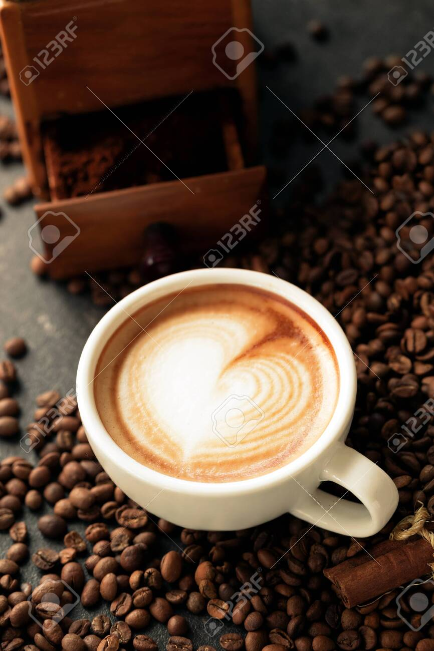 Latte art on a tide of coffee beans, coffee background - 148322118