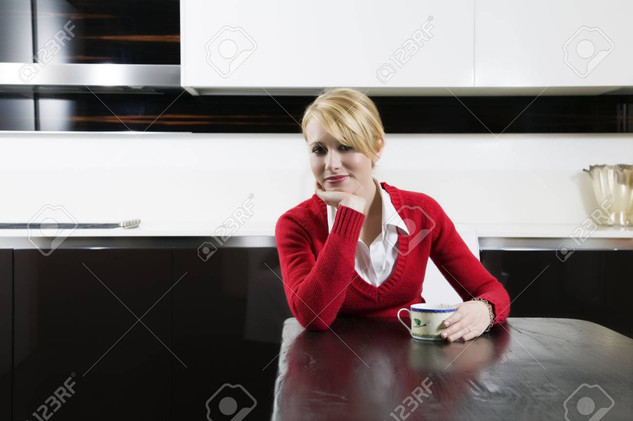 home life: woman relaxing and drinking a cup of tea Stock Photo - 2206537