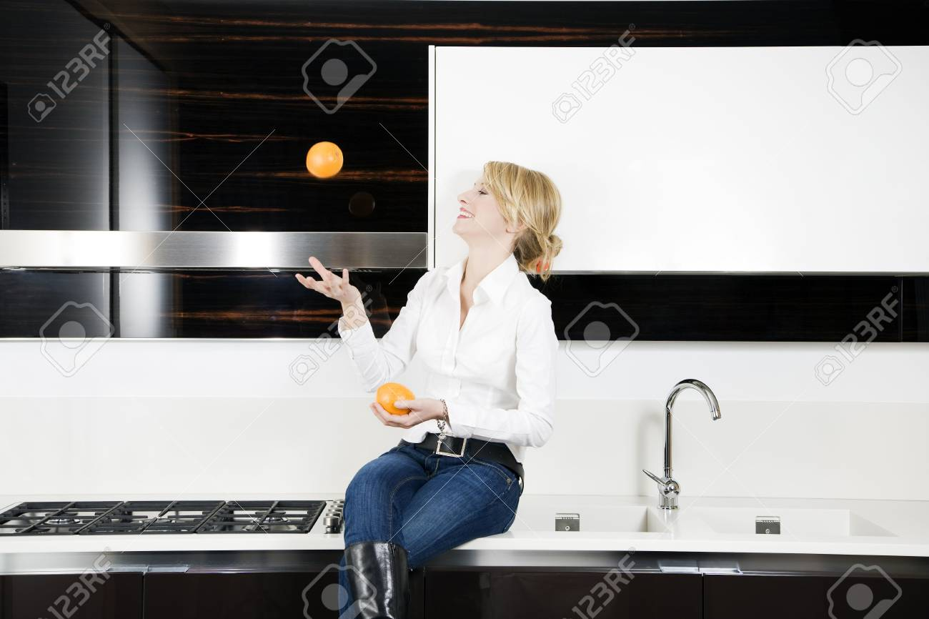 home life: woman relaxing and playing with oranges Stock Photo - 2242747