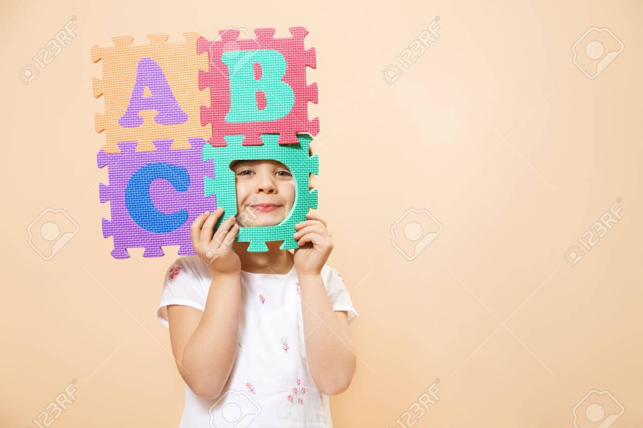child learning the ABC's. The focus is on her eyes Stock Photo - 2867696