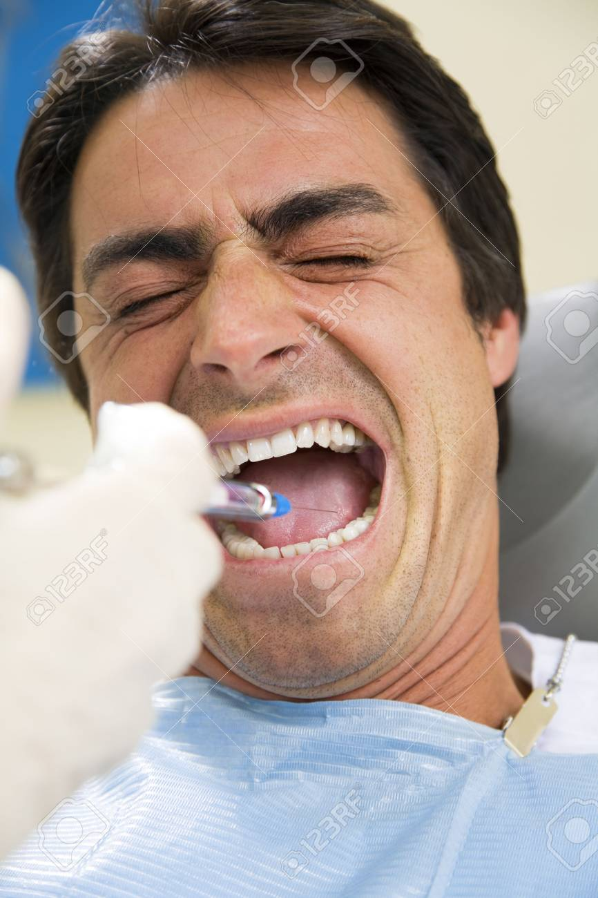 dentist holding a syringe and anesthetizing his patient Stock Photo - 2891643
