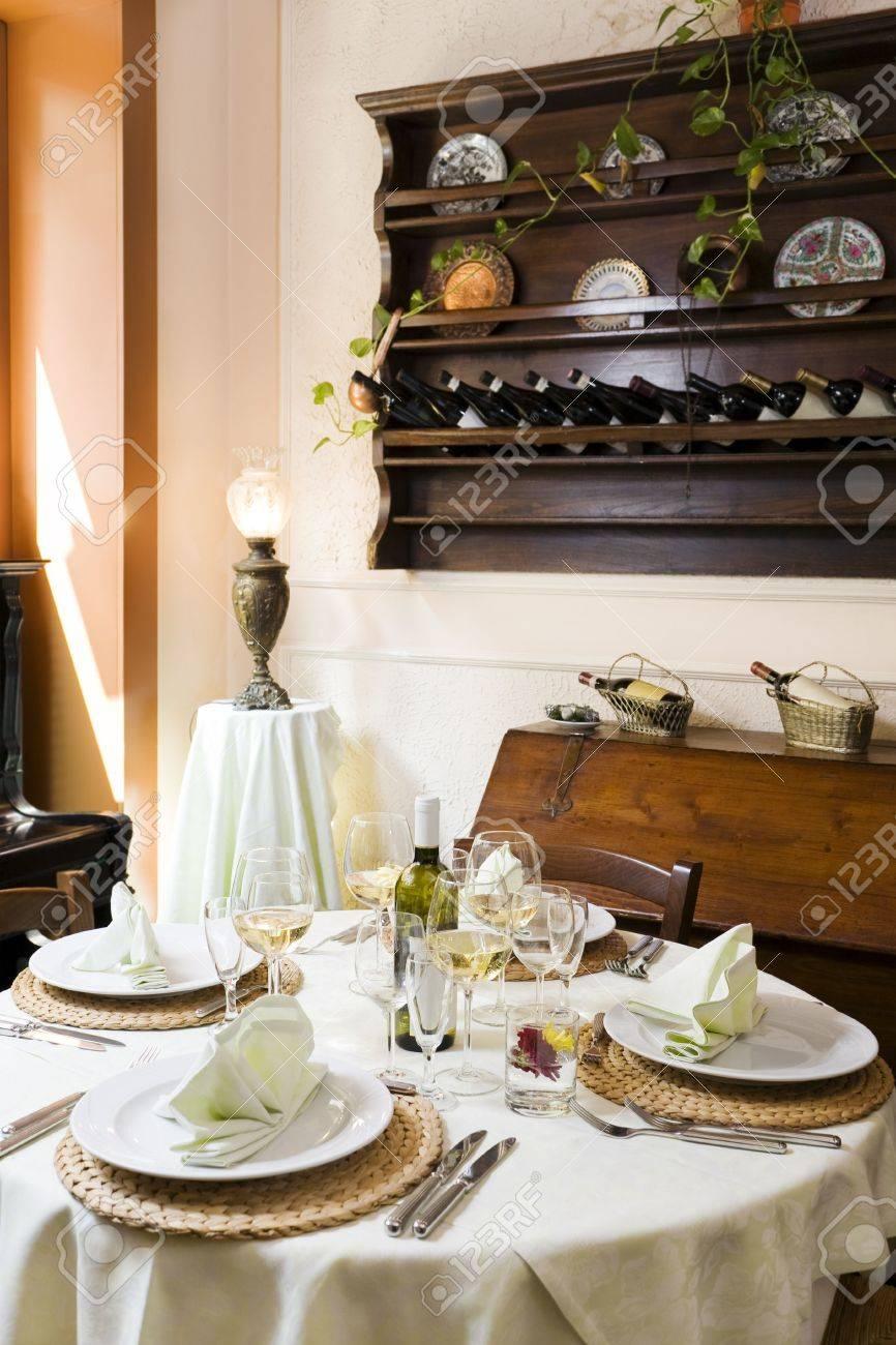 Fancy restaurant table setting - Fine Restaurant Table Setting And Wine Bottles Stock Photo 3262520