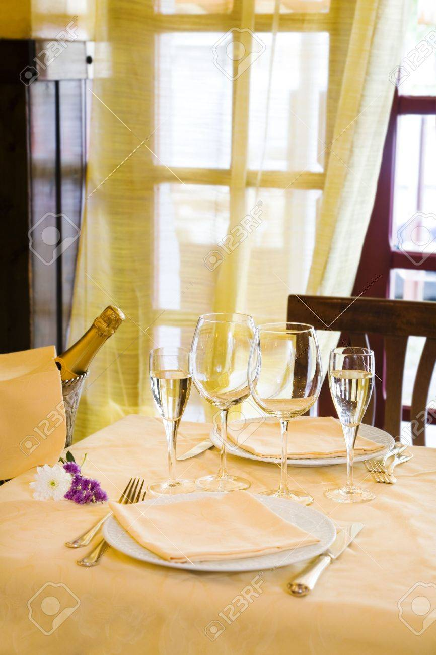 Fancy restaurant table setting - Stock Photo Fine Restaurant Table Setting And Champagne Bottle