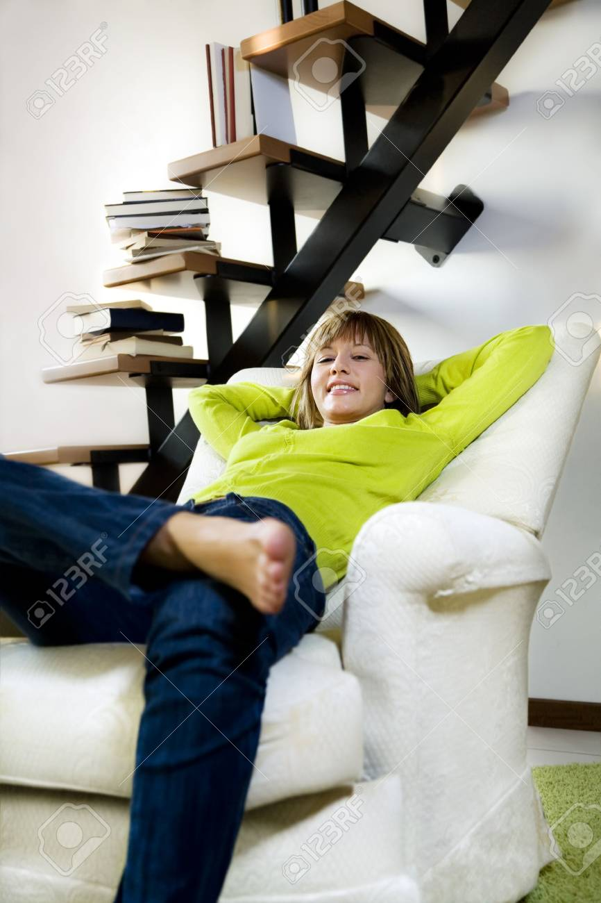 Portrait of young woman relaxing in chair at home Stock Photo - 3841554
