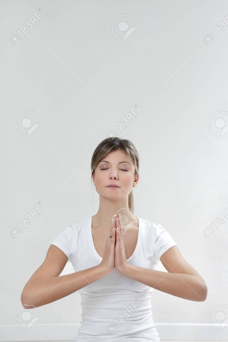 young woman doing yoga indoors. Copy space Stock Photo - 4041550