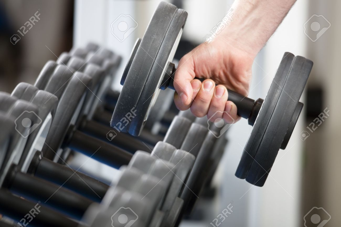 close up of man holding weight in gym Stock Photo - 4337157