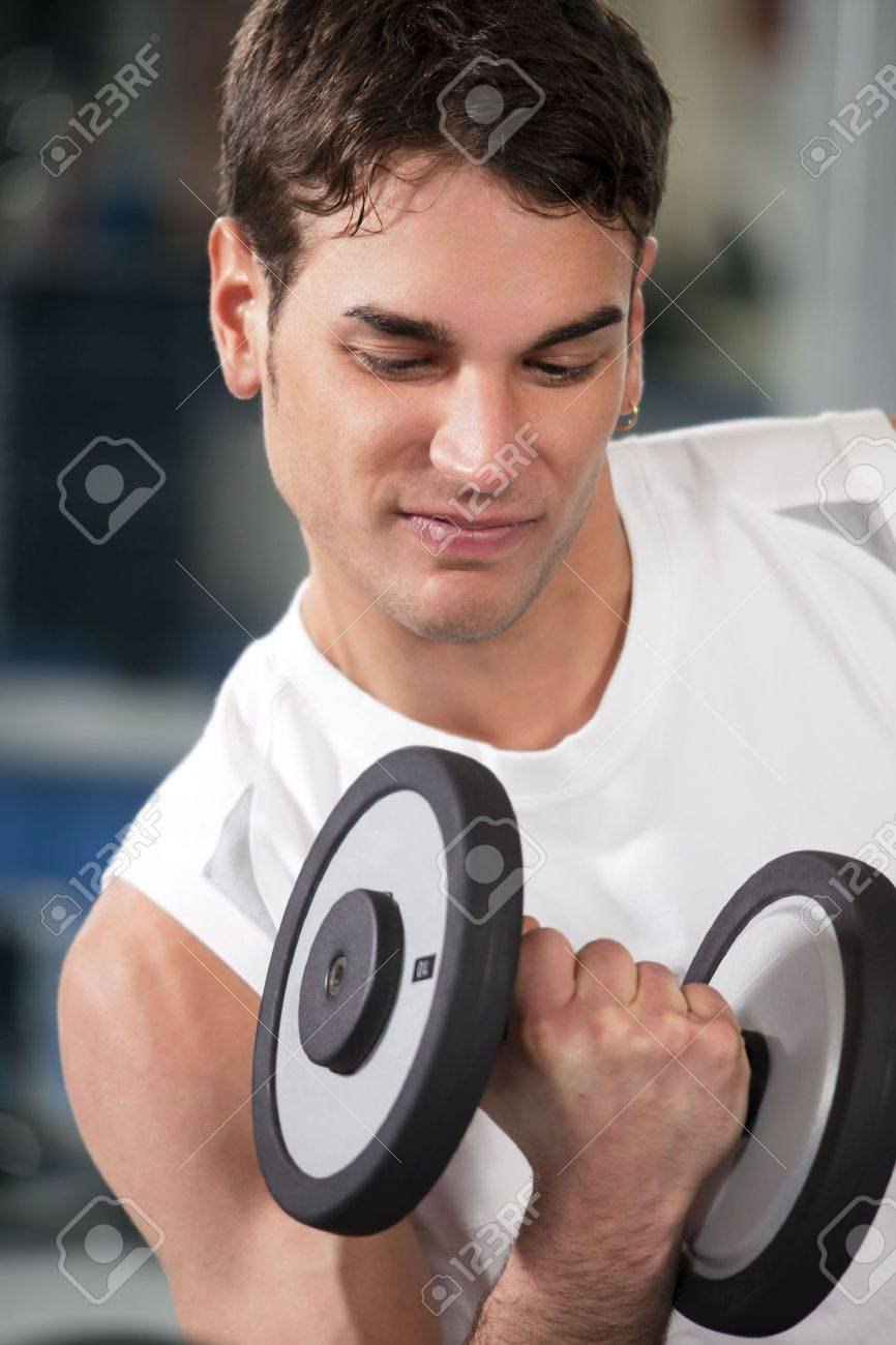 portrait of young man doing weightlifting in gym Stock Photo - 4337159