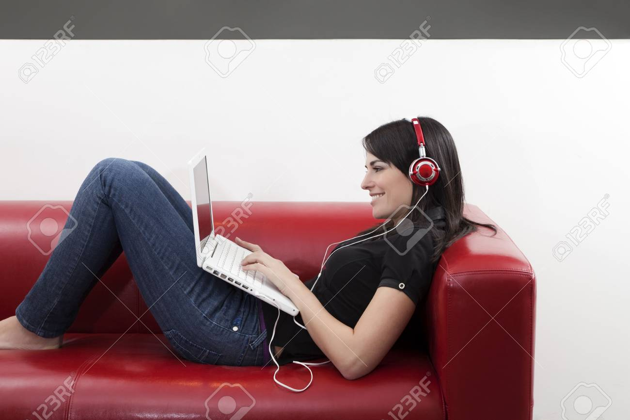 mid adult woman listening to music at home. Copy space Stock Photo - 4357317