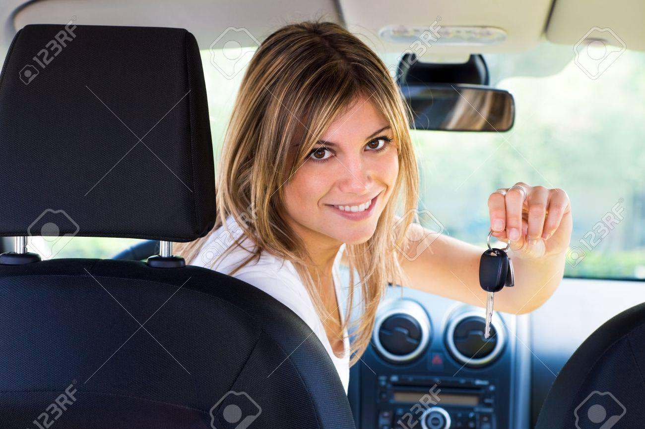 rear view of woman holding keys to new car Stock Photo - 4712539