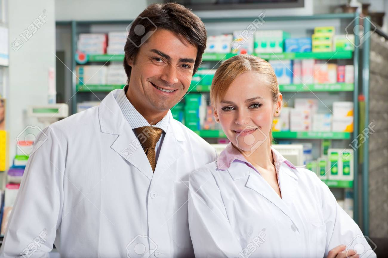 portrait of two pharmacists looking at camera and smiling Stock Photo - 4724268