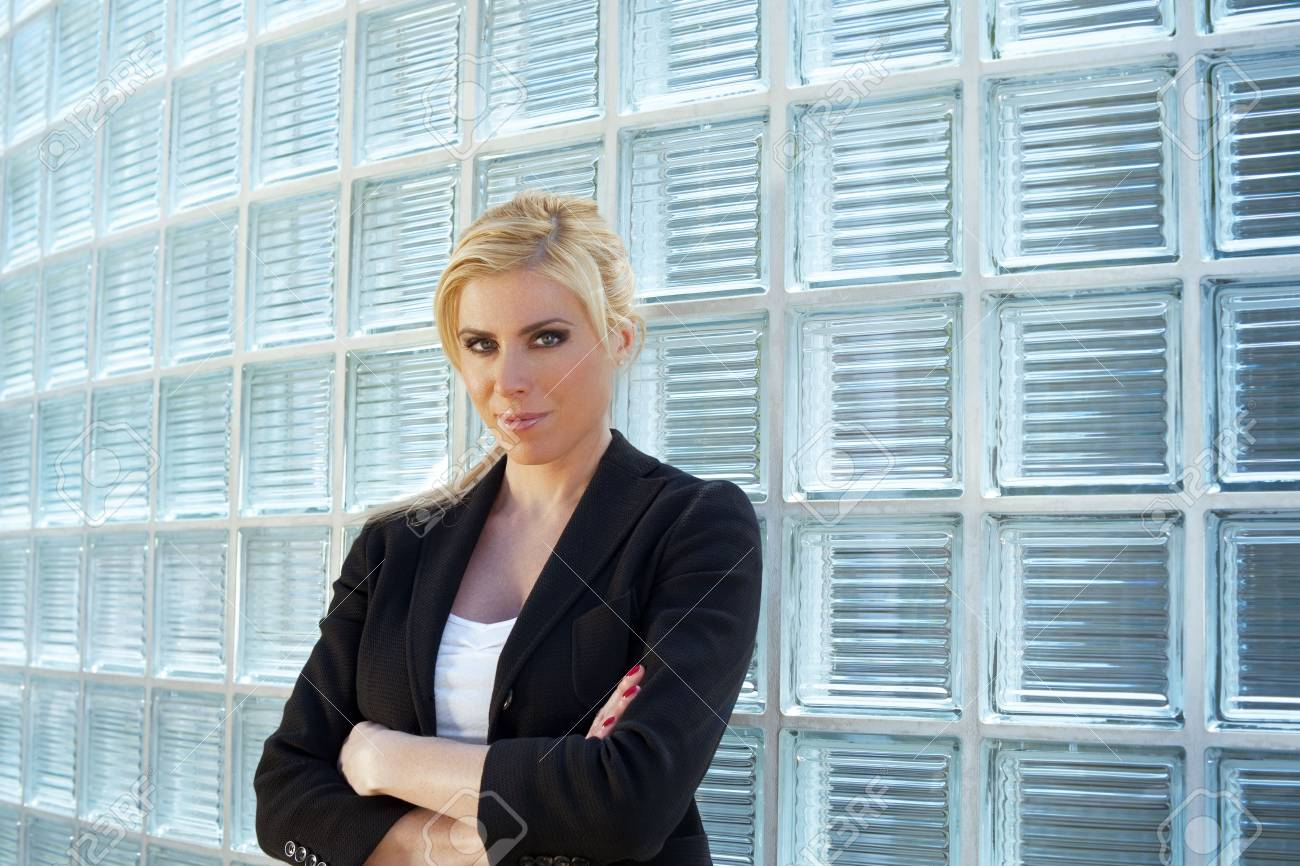 portrait of blonde businesswoman with arms folded looking at camera. Copy space Stock Photo - 4807234