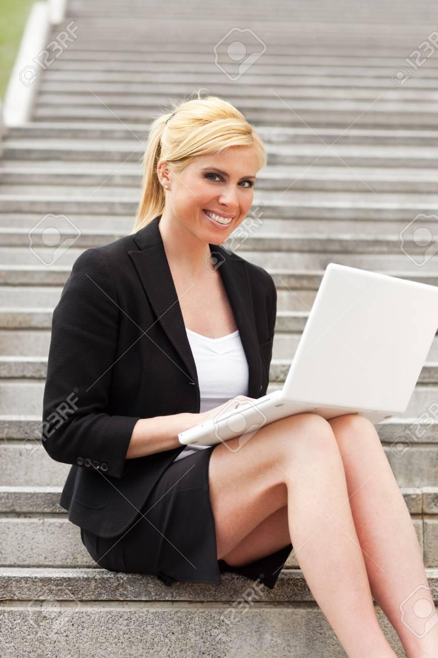 blonde businesswoman using computer laptop outdoors Stock Photo - 4837381