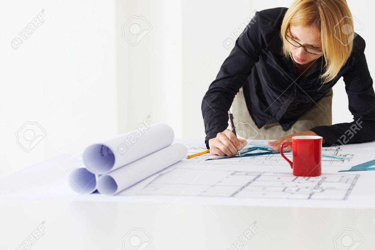 portrait of female architect drawing line on blueprint. Copy space Stock Photo - 5192087