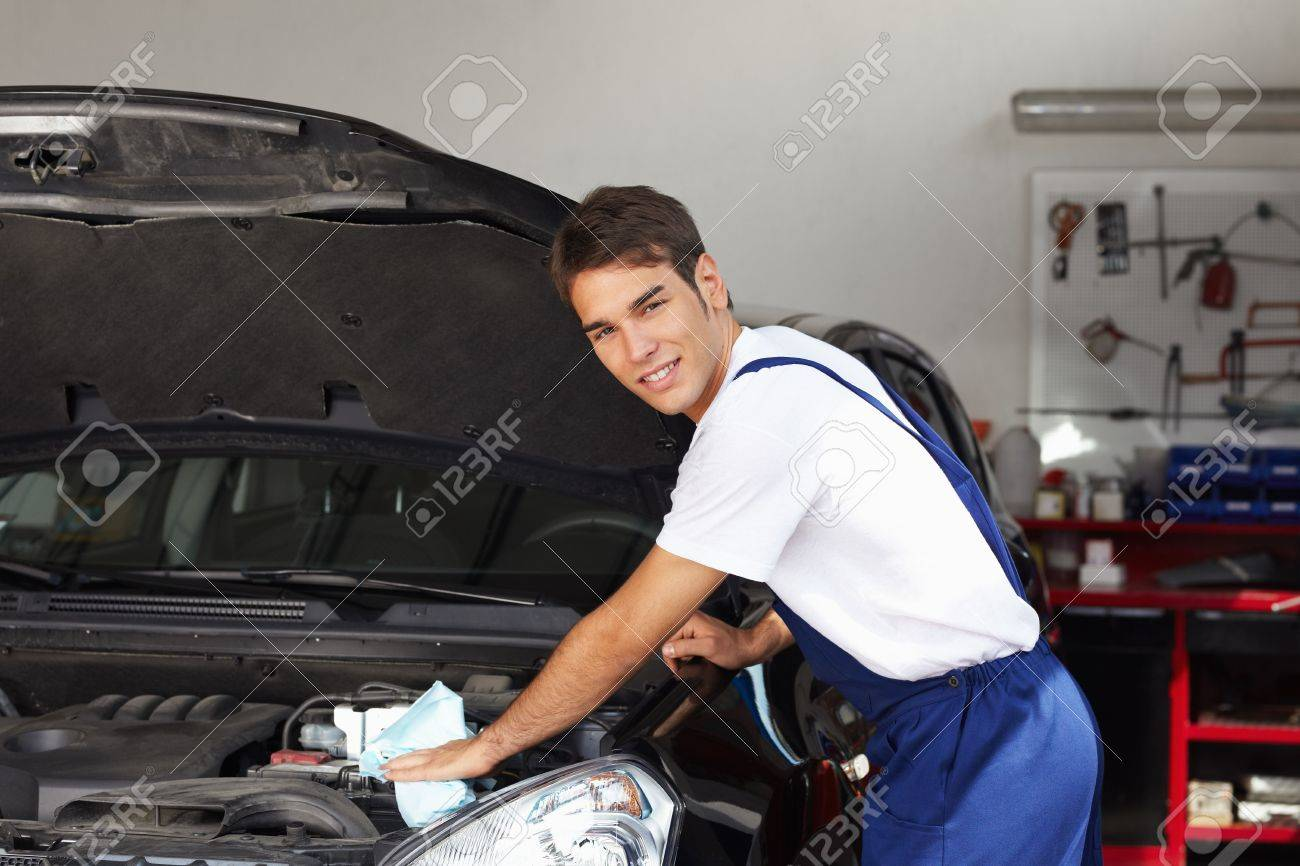 mechanic cleaning car engine and looking at camera Stock Photo - 5214092
