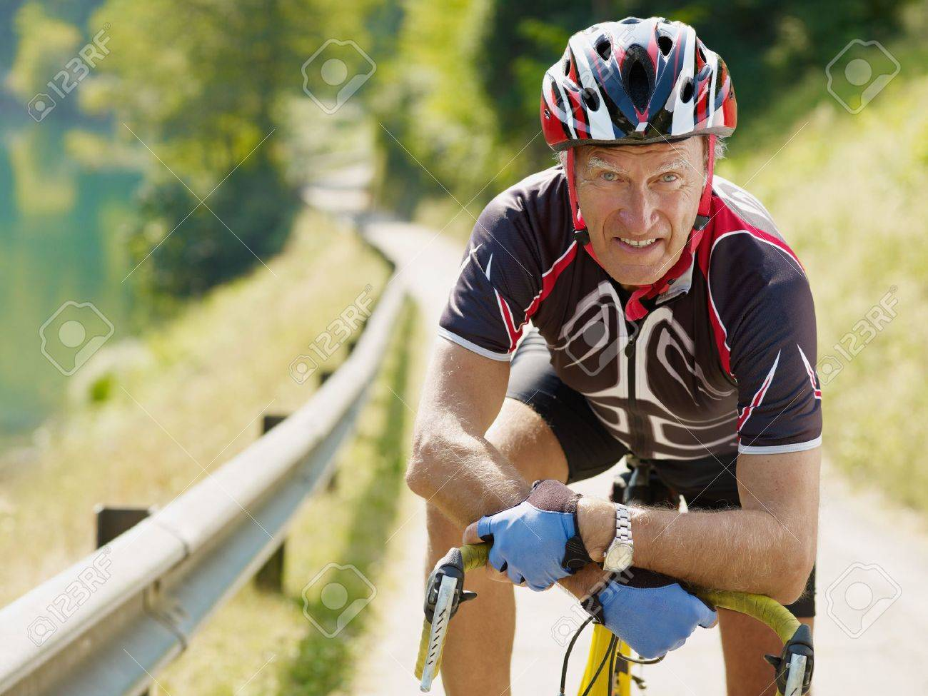senior man leaning on road bike, looking at camera. Stock Photo - 5562201