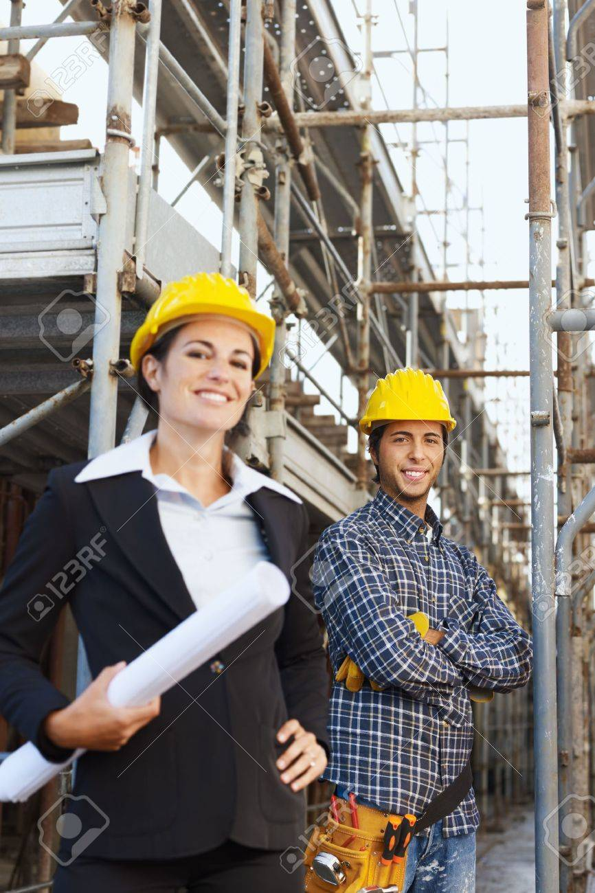 Portrait of construction worker and female architect. Copy space Stock Photo - 5880664