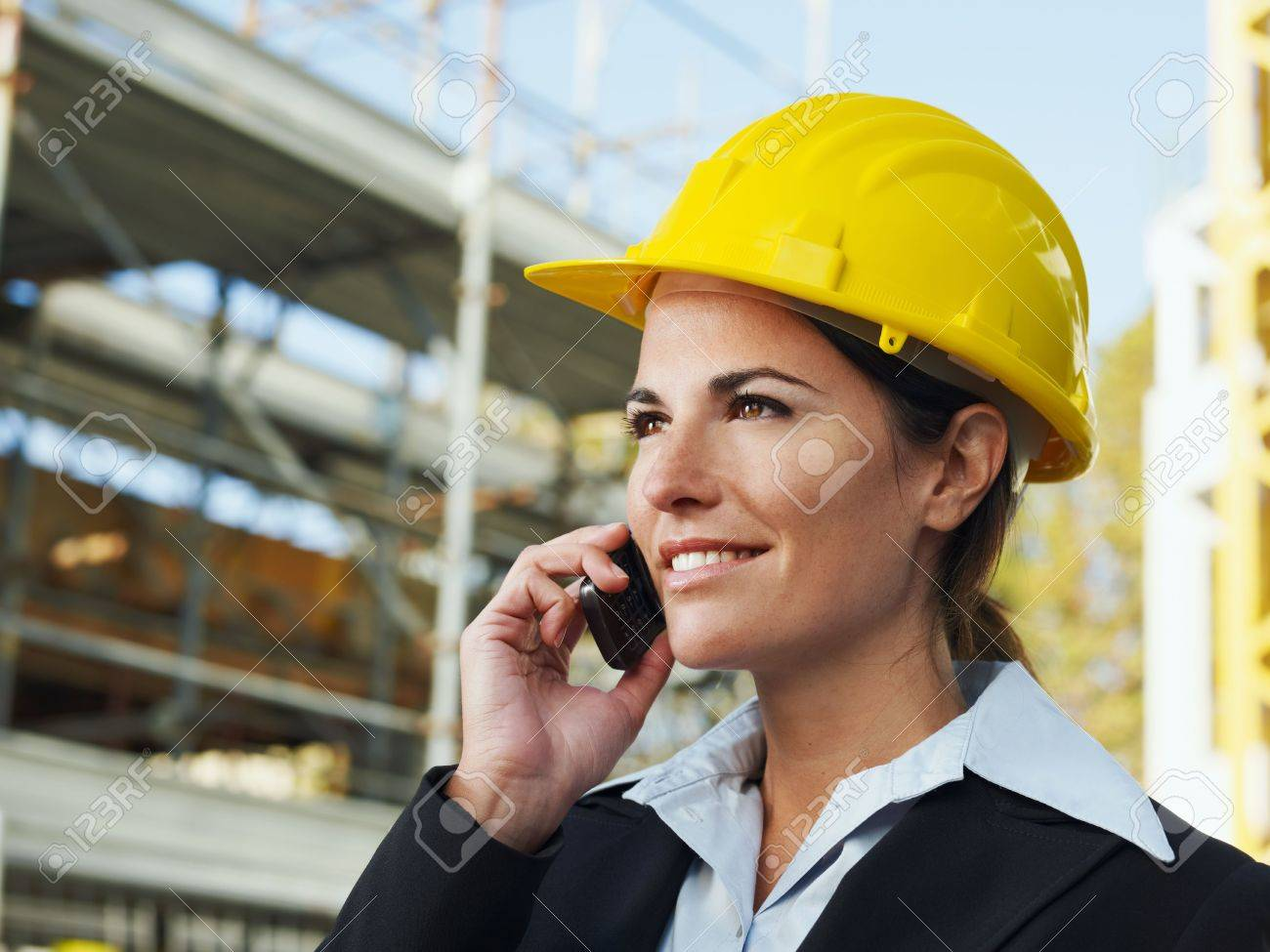 female engineer talking on mobile phone in construction site Stock Photo - 5908912