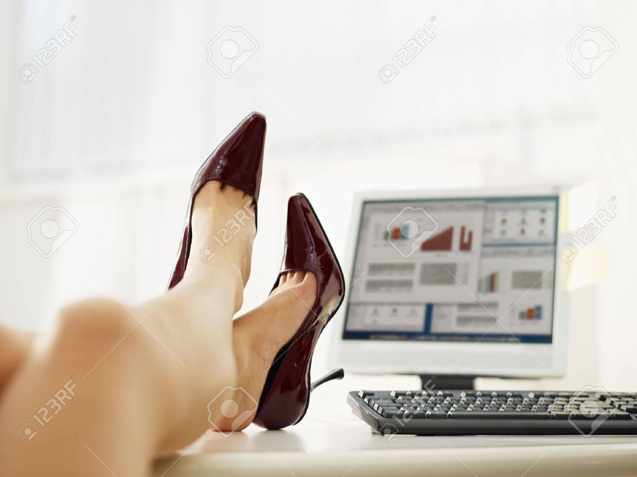 business woman taking off shoes in office. Copy space Stock Photo - 6309673
