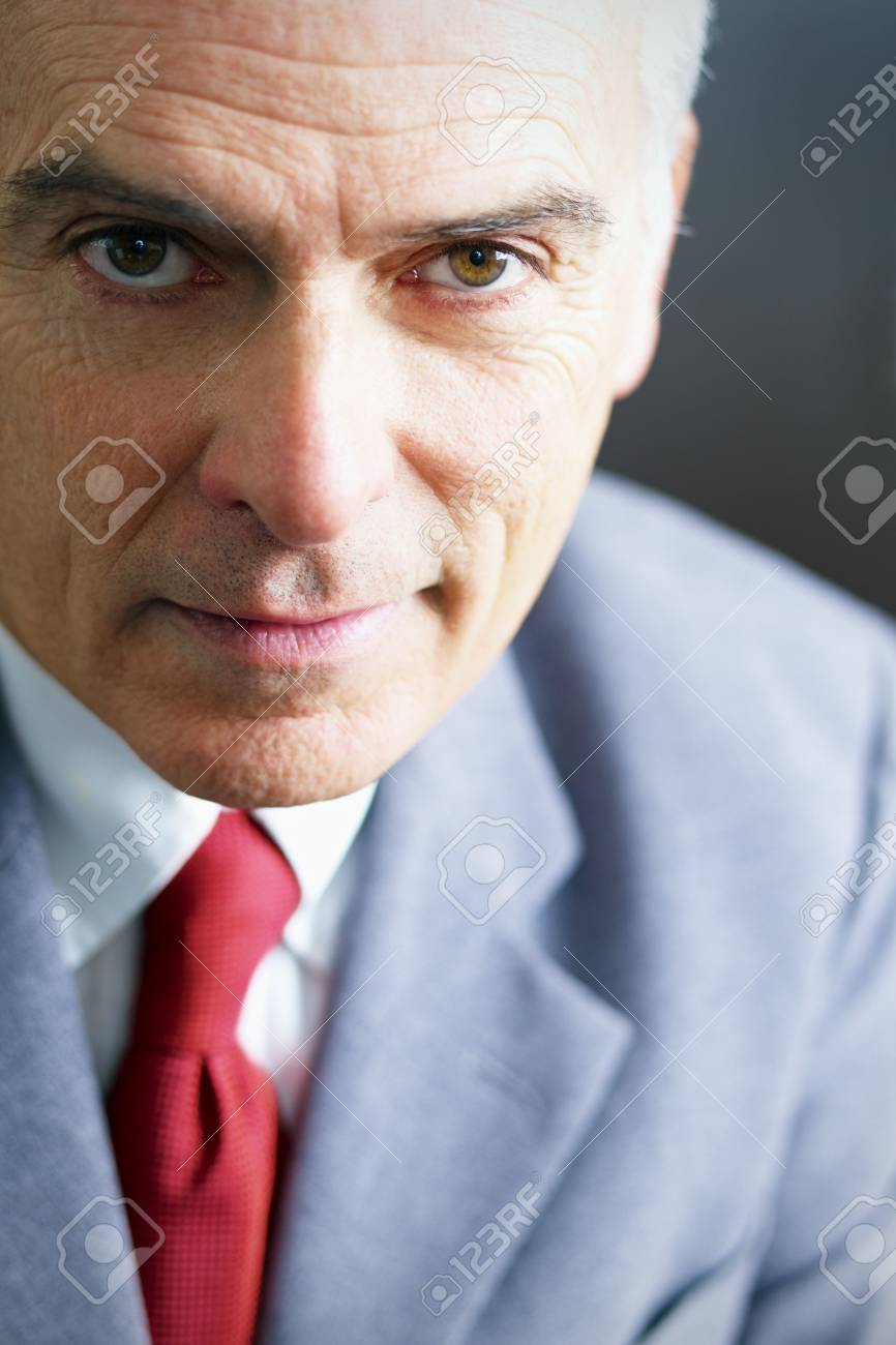 closeup of mature business man looking at camera. Copy space Stock Photo - 6309681