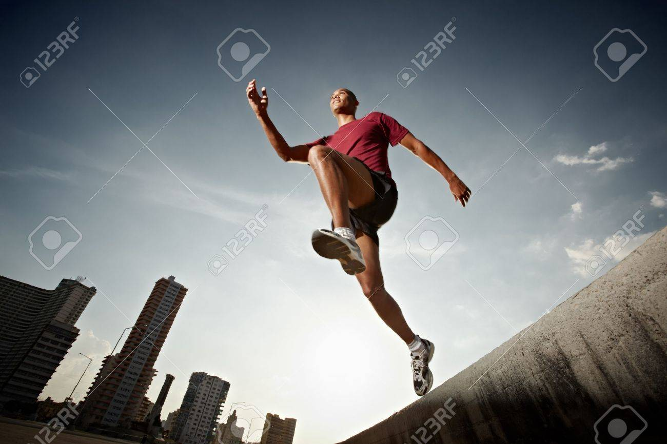 Latin american athlete running in Havana, Cuba. Horizontal shape, full length, low angle view Stock Photo - 9527198