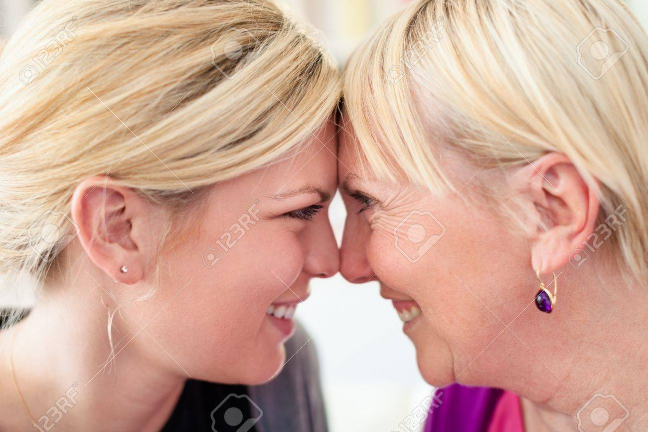 Women portrait with happy mom and daughter smiling, face to face, showing love and affection. Close up Stock Photo - 13408916