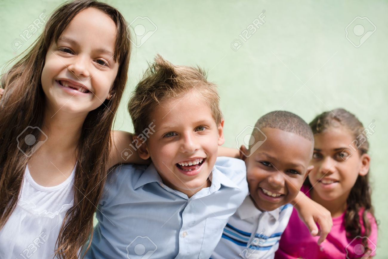 Group of happy children smiling, embracing and looking at camera. Copy space Stock Photo - 14300491
