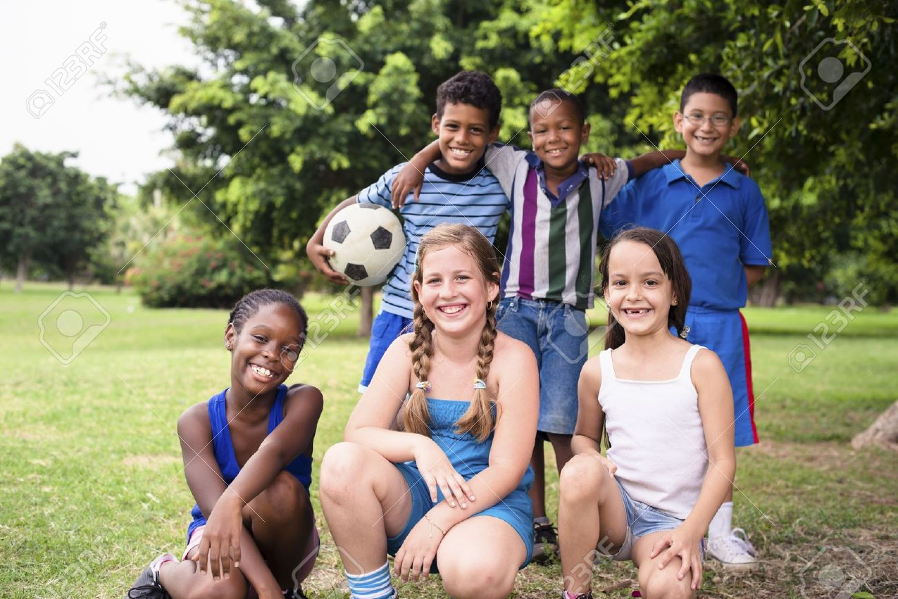 Young boys and sport, portrait of three young children with football looking at camera. Summer camp fun Stock Photo - 15893952