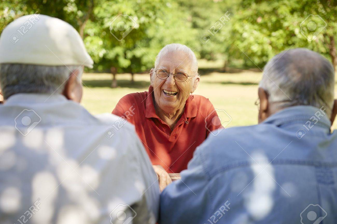 Active retired senior people, old friends and leisure, group of three elderly men having fun, laughing and talking in city park. Waist up Stock Photo - 17700471