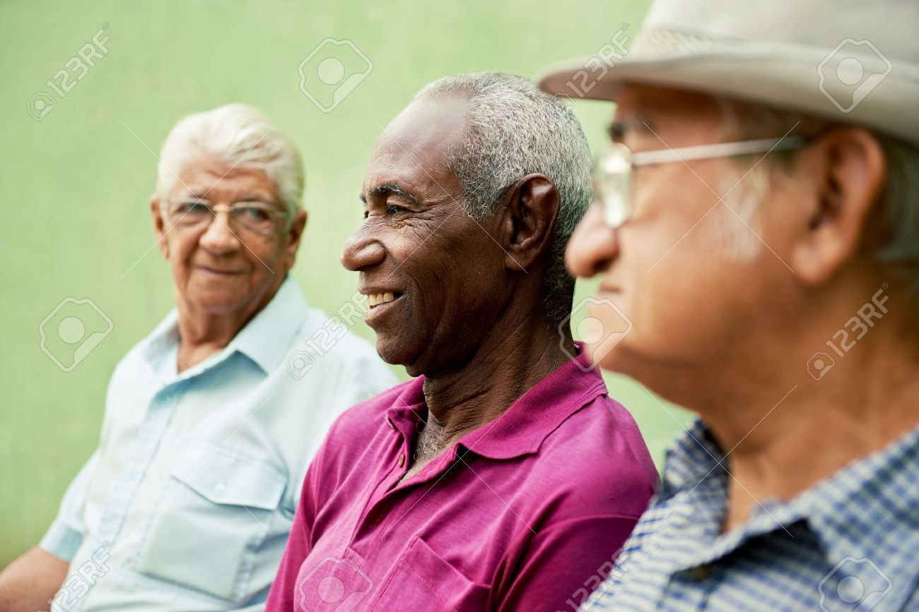 retired elderly people and free time, group of happy senior african american and caucasian male friends talking and sitting on bench in park Stock Photo - 18064667