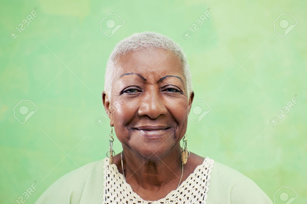 Old black woman portrait lady in elegant clothes smiling on