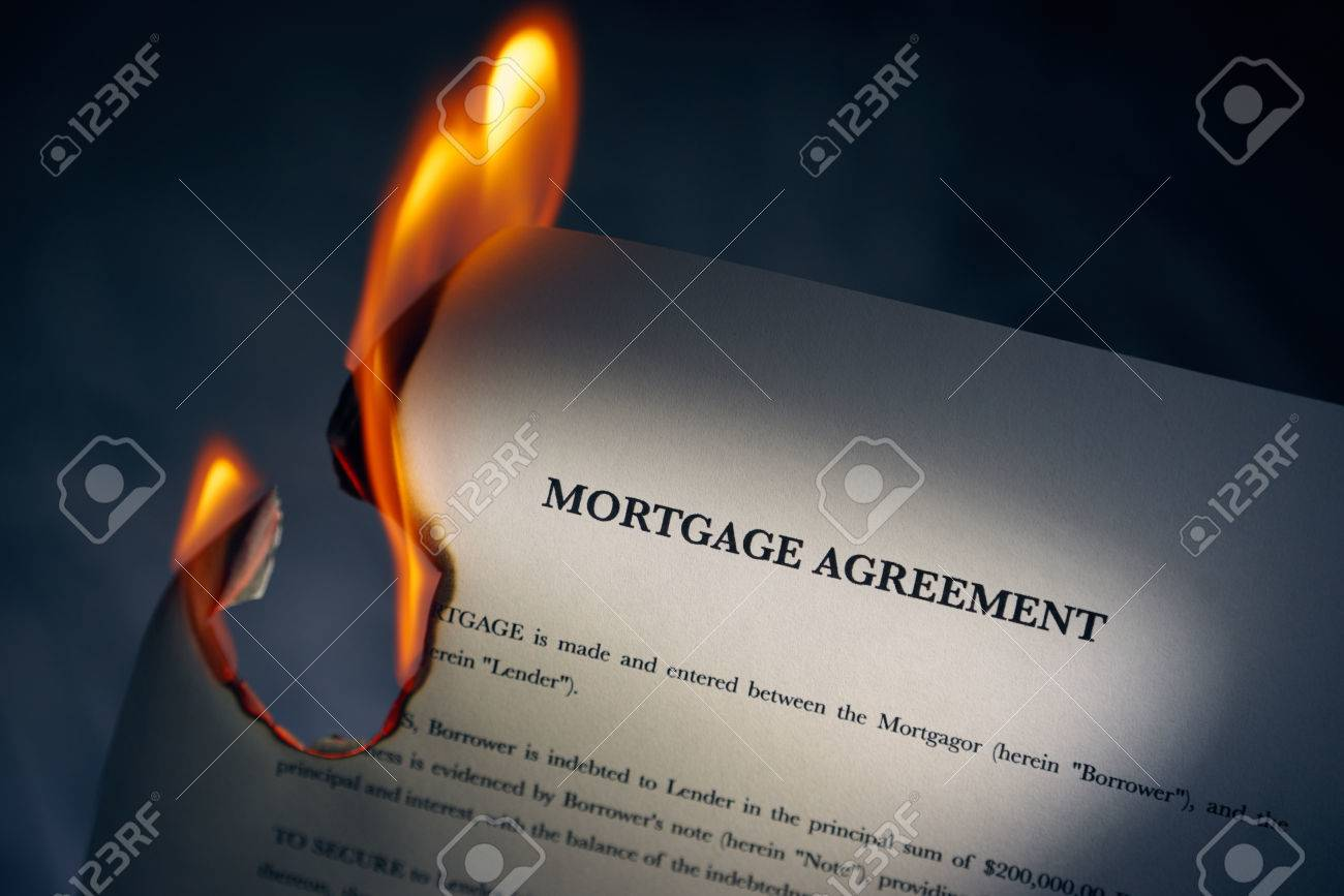 Closeup of morgage loan agreement burning. Concept shot of freedom from debts and new beginnings - 44394927