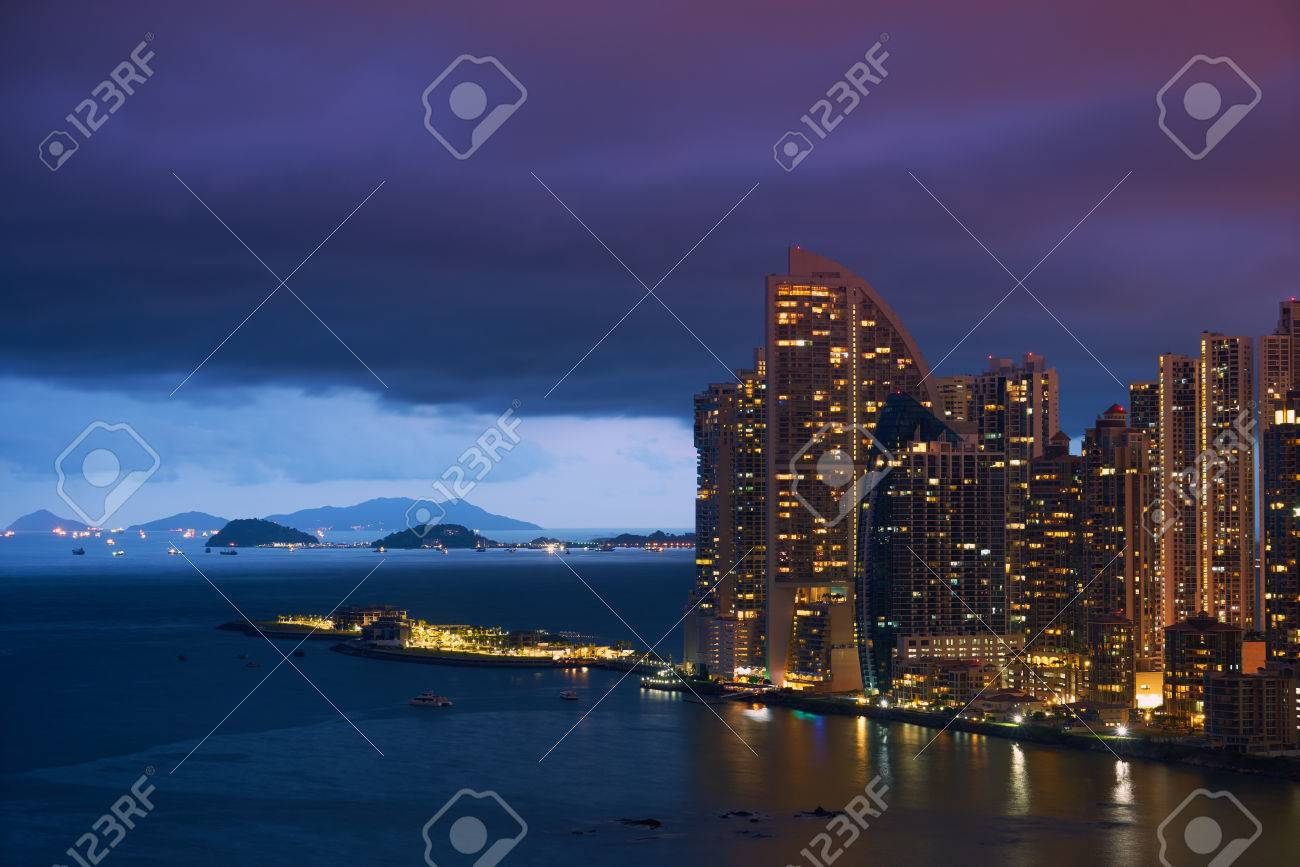 Panama City, view of Punta Pacifica district, boats waiting to enter the Canal and the Trump Tower Skyscraper at sunset - 46923684