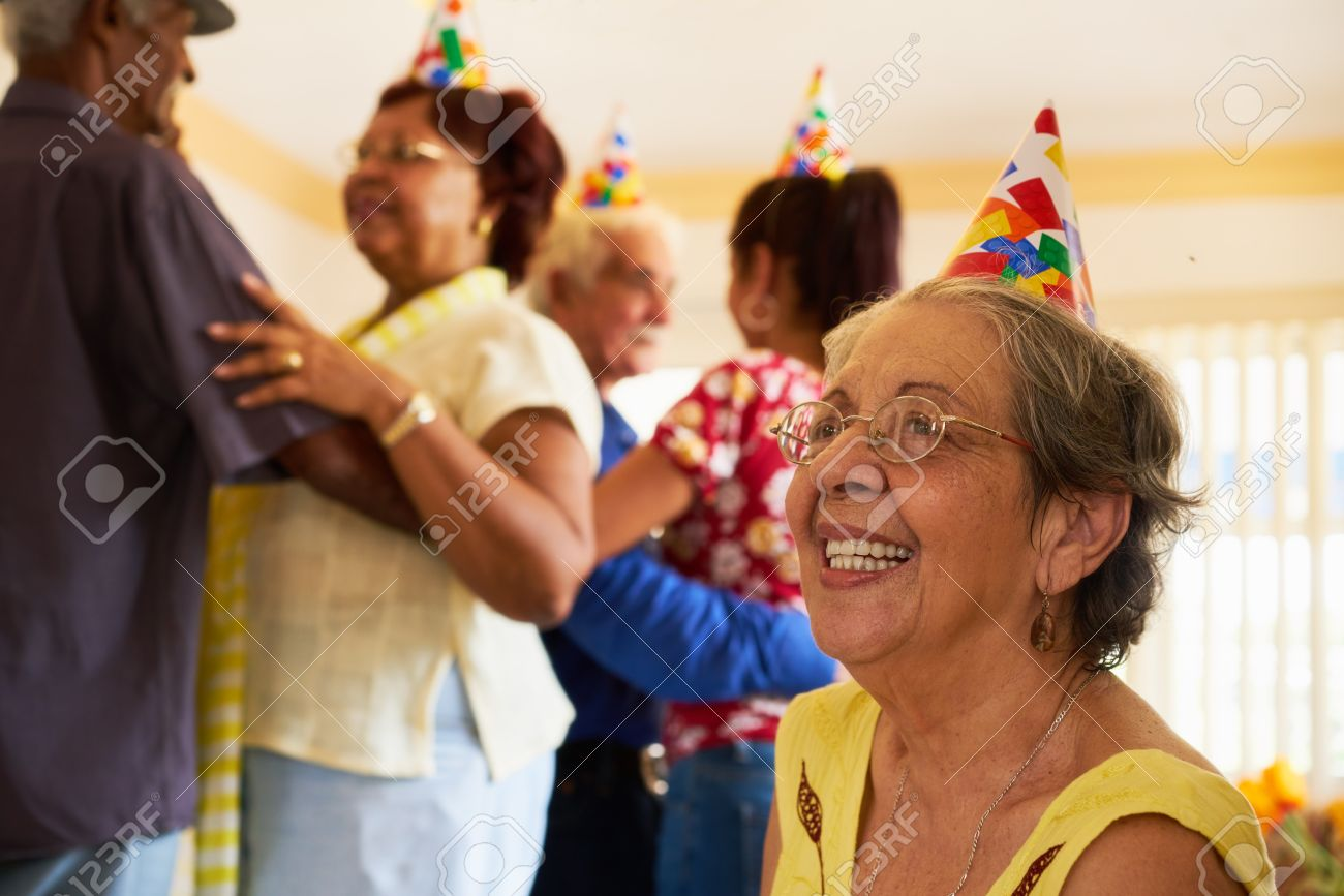 Group of old friends and family celebrating senior birthday party in retirement home. Patient woman smiling in hospice. - 66578638