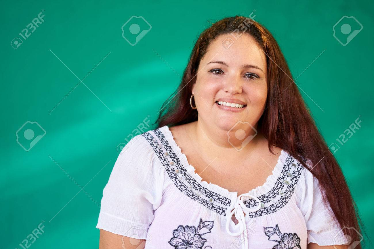 Cuban people and emotions, portrait of latina laughing and looking at camera. Happy obese hispanic young woman from Havana, Cuba smiling - 67514419