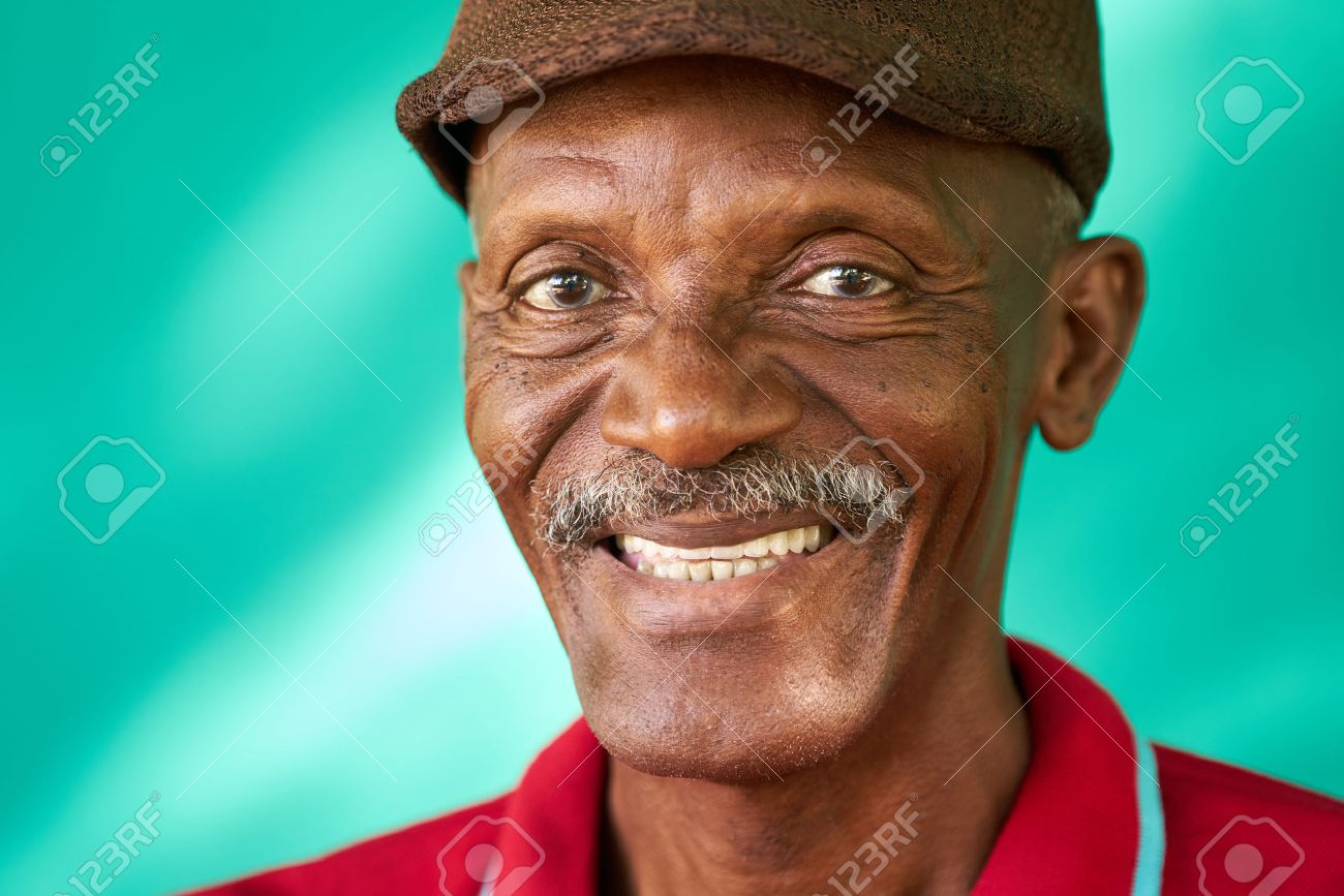 Real Cuban people and feelings, portrait of happy senior african american man looking at camera. Cheerful old latino grandfather with mustache and hat from Havana, Cuba - 67515618