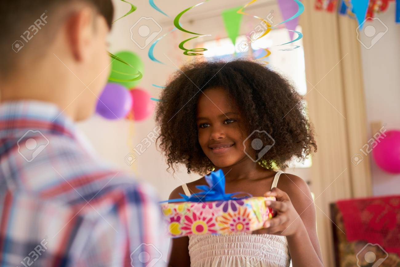 Group of happy children celebrating birthday at home kids having fun at party cute